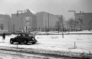 """Bernauerstraße and poster """"Unser 5-Jahresplan"""" in Berlin 1950"""
